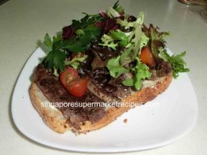 Steak sandwich open with salad